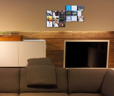 The picture shows three of our CD shelves wall mounted CD Wall3x3 about in the reading room