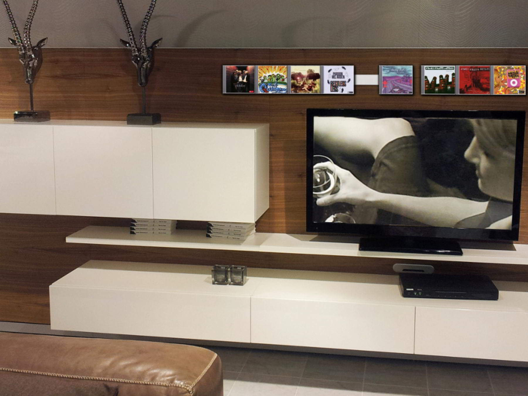 The image shows several horizontally arranged side by side CD Wall Shelves CD Wall1x3 flat arranged over the flat screen